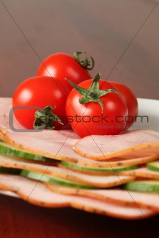 Tomatoes on ham slices