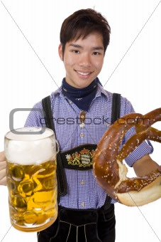Happy man holds Oktoberfest beer stein (Mass) and Pretzel in han