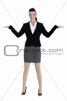 Beautiful business woman streching both the hands and pointing empty space