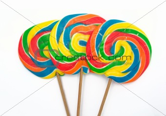three lollipops on white background