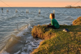 boy looking over lake