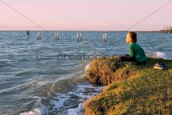boy looking over lake