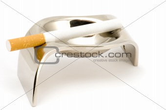 ash-tray with cigarette