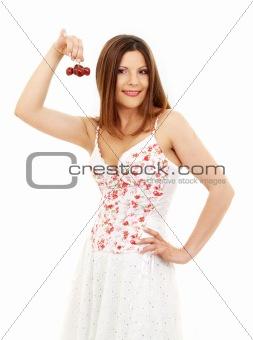 beautiful brunette girl holding cherries