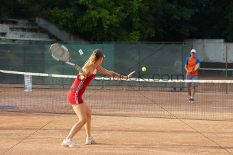 blond girl playing tennis