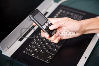 cell phone over the notebook