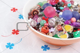 Bowl of beads and buttons