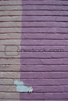 Background. Painted brickwall with peeling paint.