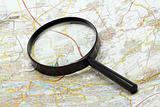 Handglass on a map