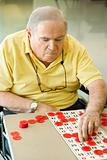 Elderly Caucasian playing bingo.