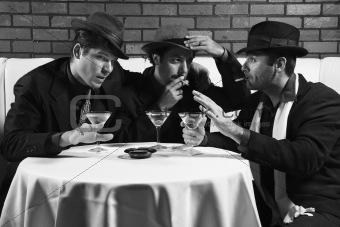 Three retro businessmen drinking, smoking and talking.