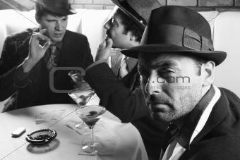 Three retro businessmen sitting at table.