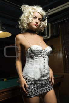 Retro female standing in beside pool table.