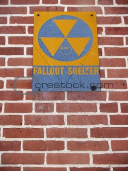 """Signs"": Old Nuclear Fallout Shelter Sign on Brick"