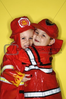Caucasian twin boys dressed as firemen.