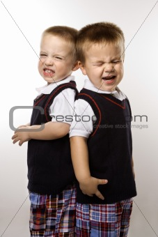Caucasian twin boys crying.