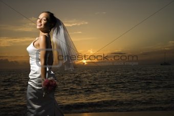 Bride on beach.