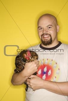 Caucasian man holding Golden Laced Wyandotte chicken.