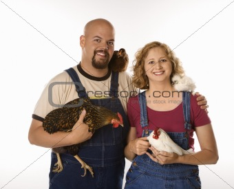 Caucasian woman and man with chickens.