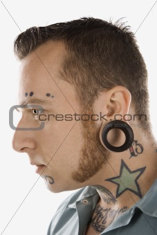 Adult male with tattoos and piercings.