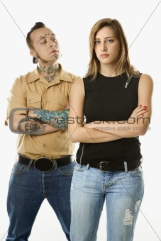Caucasian man and teen female standing together.