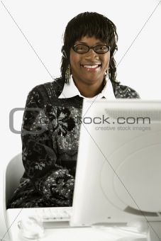Adult female typing on computer.
