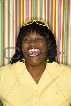 Adult African-American female laughing.