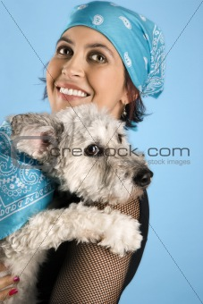 Adult female holding small white dog.