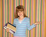 Girl holding books.