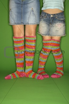 Girls wearing striped socks.