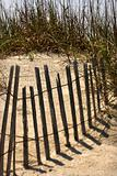 Fence on sand dune on Bald Head Island, North Carolina.