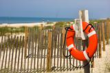 Life preserver on beach on Bald Head Island, North Carolina.
