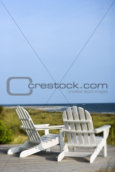Adirondack chairs overlooking beach on Bald Head Island, North C