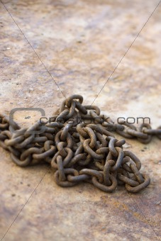 Chain on rusty metal.
