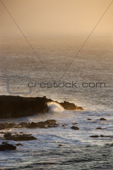 Waves on rocky shore.