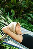 Woman relaxing in hammock.