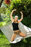 Woman playing on hammock.