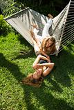 Women playing on hammock.