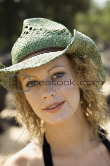Portrait of young-adult female in hat.