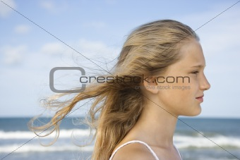 Portrait of pre-teen girl  with hair blowing.