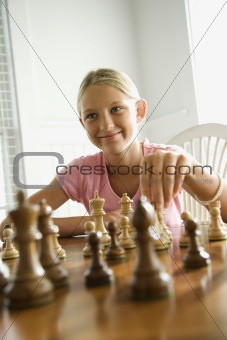 Girl playing chess.