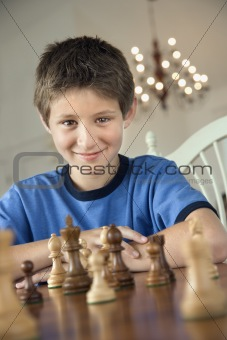Boy playing chess.