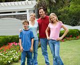 Portrait of family outside in yard.