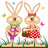 Funny rabbits with basket of easter eggs