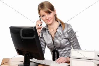 Business woman  in front of her desktop computer