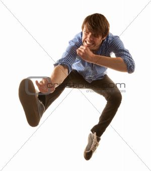 Tall handsome hipster man on white background jumping