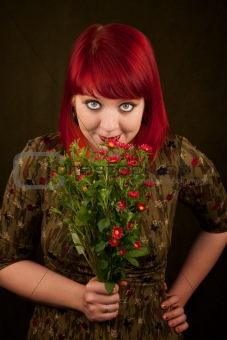 Pretty punky girl with brightly dyed red hair and flowers