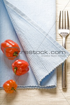 fork and peppers on blue napkin