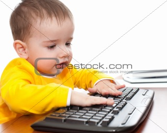 Toddler typing on the keyboard