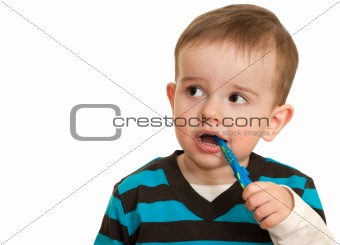Toddler is brushing his teeth
